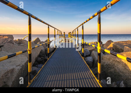 Small pier on the North Breakwater overlooking the gulf of Gdansk near the beach at Westerplatte. Gdansk, Poland - Stock Photo