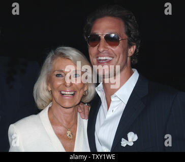 Actor Matthew McConaughey, one of the stars of the new motion picture drama 'Two for the Money' and wearing a magnolia in his lapel in support of hurricane victims, arrives with his mother Kay at the film's premiere in Beverly Hills September 26, 2005. The film also stars Al Pacino, Rene Russo and Jaime King and is about a former college football star who suffers a career-ending injury and aligns himself with one of the most renowned bookies in the sports gambling business. The movie opens October 7 in the United States.   (UPI Photo/Jim Ruymen) - Stock Photo