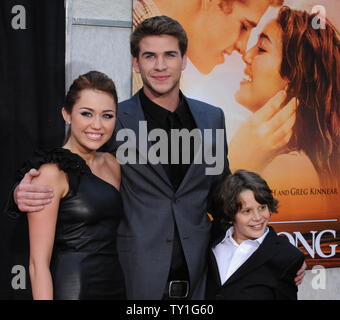 Miley Cyrus (L), Liam Hemsworth of Australia (C) and Bobby Coleman, who co-star in the motion picture drama 'The Last Song', attend the premiere of the film at the Arclight Cinerama Dome in Los Angeles on March 25, 2010.     UPI/Jim Ruymen - Stock Photo