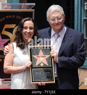 Singer, composer and songwriter Randy Newman is joined by his wife Gretchen Pierce during an unveiling ceremony honoring him with the 2,411th star on the Hollywood Walk of Fame in front of the historic Musso & Frank Grill in Los Angeles on June 2, 2010.     UPI/Jim Ruymen - Stock Photo