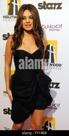 Actress Mila Kunis arrives on the red carpet for the 14th annual Hollywood Film Festival Awards presented by Starz Entertainment at the Beverly Hilton Hotel in Beverly Hills, California on October 25, 2010. Honorees include: Sean Penn, Sylvester Stallone, Annette Bening, Robert Duval and Zach Galifanakis.   UPI/Jim Ruymen - Stock Photo