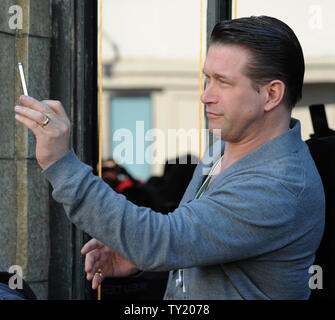 Actor Stephen Baldwin records the moment during an unveiling ceremony honoring his brother Alec Baldwin with the 2,433rd star on the Hollywood Walk of Fame in Los Angeles on February 14, 2011.  UPI/Jim Ruymen - Stock Photo