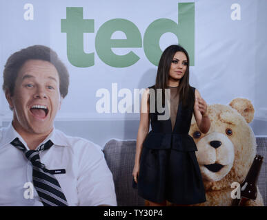 Actress Mila Kunis, a cast member in the motion picture comedy 'Ted', attends the premiere of the film at Grauman's Chinese Theatre in the Hollywood section of Los Angeles on June 21, 2012.  UPI/Jim Ruymen - Stock Photo