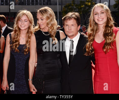 Actors Michael J. Fox and his wife Tracy Pollan (2nd-L) attend The Academy of Television Arts & Sciences Creative Arts Emmy Awards with their twin daughters Schuyler (L) and Aquinnah (R) at the Nokia Theatre in Los Angeles on September 15, 2012.  UPI/Jim Ruymen - Stock Photo