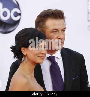 Actor Alec Baldwin (R) and wife Hilaria Baldwin arrive for the the 64th Primetime Emmys at the Nokia Theatre in Los Angeles on September 23, 2012. UPI/Danny Moloshok - Stock Photo