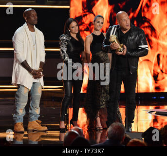 Actor Vin Diesel accepts the MTV Generation Award for 'The Fast and the Furious' franchise to  onstage with cast members Tyrese Gibson, Michelle Rodriguez, and Jordana Brewster  during the MTV Movie & TV Awards at the Shrine Auditorium in Los Angeles on May 7, 2017. It will be the 26th edition of the awards, and will for the first time present honors for work in television as well as cinema.  Photo by Jim Ruymen/UPI - Stock Photo