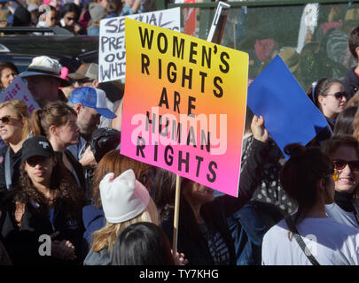 Hundreds of thousands of people took to the streets of downtown Los Angeles and across the nation today, as the second annual Women's March looked to convert anger at President Donald Trump's policies into victories in this year's elections. An estimated 350,00 people rallied at City Hall in Los Angeles on January 20, 2018. The coordinated rallies in L.A., Washington, D.C., Chicago, New York, Santa Ana, Palm Springs and other cities also aimed to repeat the success of last year's demonstrations, where an estimated 3 to 4 million took to the.streets to protest Trump's inauguration.  Photo by Ji - Stock Photo