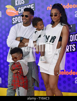 Singer Ciara (R), Seattle Seahawks quarterback Russell Wilson and their children Future Jr. and Sienna attend Nickelodeon's KIds' Choice Sports Awards 2018 at Barker Hangar in Santa Monica, California on July 19, 2018. Photo by Chris Chew/UPI - Stock Photo