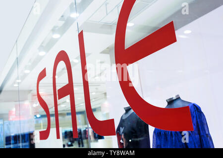 sale word with shop window - Stock Photo
