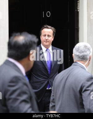 British Prime Minister David Cameron leaves No.10 Downing St to face a grilling from MP's in the House of Parliament over the Murdoch phone hacking scandal in London,England on Wednesday, July 20, 2011.      UPI/Hugo Philpott - Stock Photo
