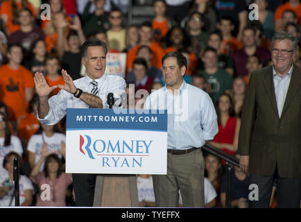 Republican presidential nominee Mitt Romney holds up the 'U'  as he delivers remarks to supporters  at the University of Miami, Coral Gables Florida on October 31, 2012. With six days left in the campaign (L-R) Senator Marco Rubio, and Former Florida Governor Jeb Bush,  joined Mitt Romney during a Victory Rally in Florida.  UPI/Gary I Rothstein - Stock Photo