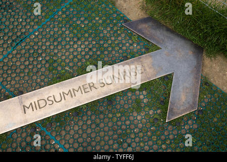 Arrow pointer in the ground at Stonehenge pointing at the position where the sun rises on the longest day of the year in summer / the summer solstice. UK. (109) - Stock Photo