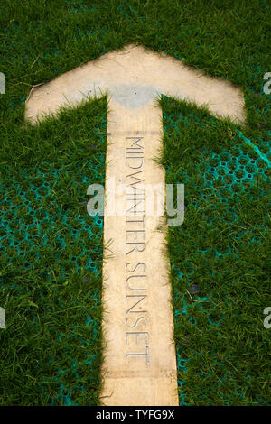 Arrow pointer in the ground at Stonehenge pointing at the position where the sun sets / midwinter sunset on the shortest day of the year in winter / the winter solstice. UK. (109) - Stock Photo