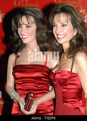 Actress Susan Lucci of the tv soap series 'All My Children' poses with her wax likeness unveiled at Madame Tussauds in New York on February 12, 2008.   (UPI Photo/Ezio Petersen) - Stock Photo