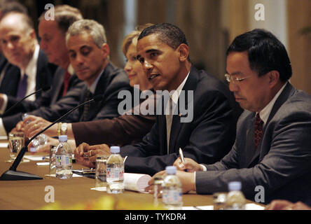 U.S. President Barack Obama (2nd R) speaks at a bilateral meeting at the Waldorf Astoria Hotel in New York City on September 22, 2009. Secretary of State Hillary Clinton (3rd R) and Obama's Chief of Staff Rahm Emanuel (3rd L) listen.   UPI Photo/John Angelillo - Stock Photo