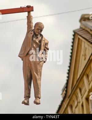 Sigmund Freud hanging figure ('Man Hanging Out'), by David Černý, Prague, Czech Republic - Stock Photo