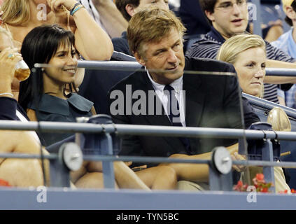Alec Baldwin massages the calf of wife Hilaria Thomas while Victoria Duval plays Kim Clijsters of Belgium at the 2012 U.S. Open Tennis Championships in Arthur Ashe Stadium at the Billie Jean King National Tennis Center in New York City on August 27, 2012.       UPI/John Angelillo - Stock Photo