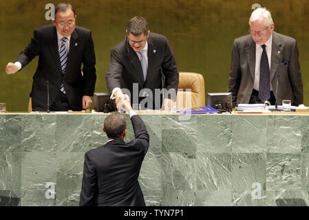 Secretary-General of the United Nations Ban Ki-moon listens watches as Vuk Jeremic General Assembly President shakes the hand of United States President Barack Obama before he addresses the United Nations at the 67th United Nations General Assembly in the UN building in New York City on September 25, 2012.      UPI/John Angelillo - Stock Photo