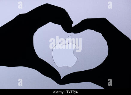 The Apple brand logo is displayed on a large screen at an Apple Special Event at the Brooklyn Academy of Music in New York City on October 30, 2018. Apple introduced the new iPad Pro, Mac Mini and MacBook Air at the event and will all be available November 7th    Photo by John Angelillo/UPI - Stock Photo
