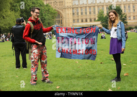 London, UK. 26th June 2019. Young couple representing extinction rebellion at a mass lobby of MP's around the Houses of Parliament in London, organised by The Climate Coalition and Greener UK, pressing for more urgent and bold action on climate change. Credit: Joe Kuis / Alamy News - Stock Photo