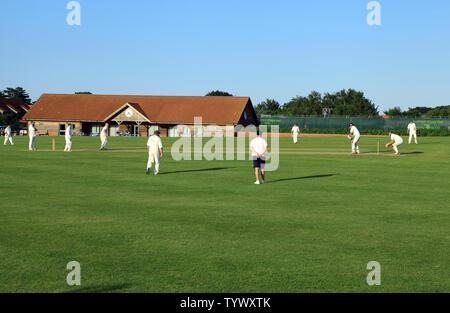 Village Cricket, sport, players, game, match, pavilion, village hall, Thornham, Norfolk, UK - Stock Photo