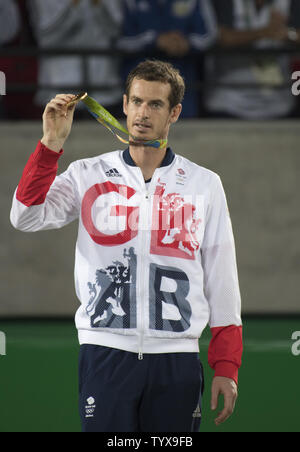 Andy Murray of Great Britain shows his gold medal from the podium after winning the Men's Singles Tennis Finals  against Juan Mart'n del Potro of Argentina at the 2016 Rio Summer Olympics in Rio de Janeiro, Brazil, on August 14, 2016.   Photo by Richard Ellis/UPI.. - Stock Photo