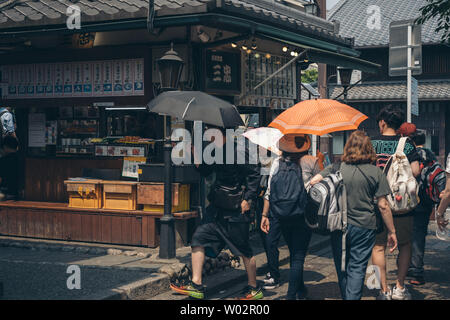 Kyoto, Japan, 22 June 2019: Tourists explore Arashiyama in the outskirts of Kyoto, Japan. Arashiyama is the famous destination for tourist in Japan. - Stock Photo