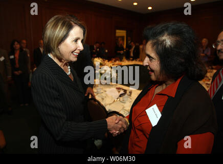 Speaker of the House Nancy Pelosi (D-CA) (L) stops to say hello to health care professionals during a breakfast meeting in St. Louis on October 4, 2009. UPI/Bill Greenblatt - Stock Photo