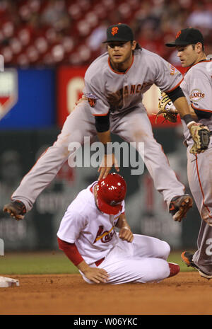 San Francisco Giants Brandon Crawford jumps over St. Louis Cardinals Pete Kozma on the front end of a double play in the 11th inning at Busch Stadium in St. Louis on June 1, 2011. San Francisco won the game 7-5 in 11 innings.   UPI/Bill Greenblatt - Stock Photo