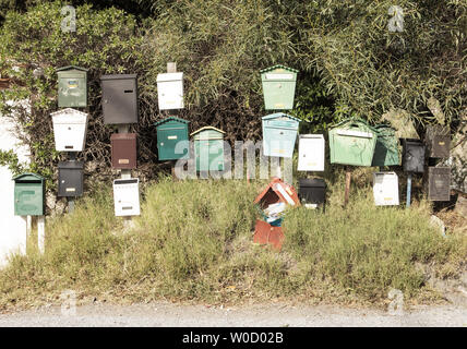 lots of letter boxs at the end of a road in spain - Stock Photo