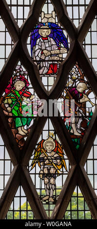 Gloria in Excelsis Deo by Christopher Whall (1902), Brockhampton-by-Ross Church, Herefordshire, UK - Stock Photo