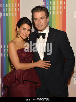 Actor Alec Baldwin and his wife Hilaria pose for photographers on the red carpet as they arrive for an evening of gala entertainment at the Kennedy Center, December 1, 2012, in Washington, DC.  The annual Kennedy Center Honors are bestowed annually on five artists for their lifetime achievement in the arts and culture.    UPI/Mike Theiler - Stock Photo