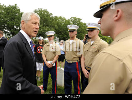US Secretary of Defense Chuck Hagel (L) chats with a group of US Marines as he visits Arlington National Cemetery on Memorial Day, in Arlington, Virginia, May 27, 2013. On Memorial Day the nation honors its military veterans and those who have died in the country's conflicts.      UPI/Mike Theiler - Stock Photo