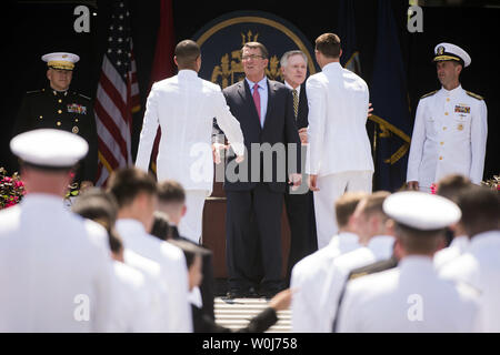 Defense Secretary Ash Carter shakes hands with a graduating Midshipmen during the 2016 Graduation and Commissioning Ceremony at the U.S. Naval Academy in Annapolis, Maryland on May 27, 2016. The graduating class consists of 1,076 men and women who will be commissioned as Navy Ensigns or 2nd Lieutenants in the U.S. Marine Corps. Photo by Kevin Dietsch/UPI - Stock Photo