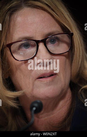 Christine Blasey Ford, the woman accusing Supreme Court nominee Brett Kavanaugh of sexually assaulting her at a party 36 years ago, testifies before the US Senate Judiciary Committee on Capitol Hill in Washington, DC, September 27, 2018.       Photo by Saul Leob/UPI - Stock Photo
