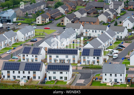 Elevated view of new houses with solar panels on roofs in Raploch district of Stirling , Scotland, UK - Stock Photo
