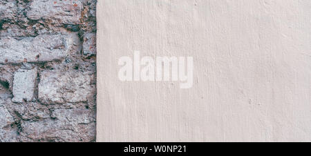 Beige new painted plastered wall with old brick wall background. - Stock Photo