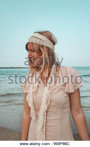 Woman standing on shore - Stock Photo