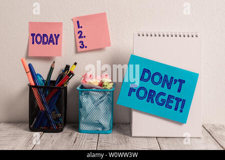 Writing note showing Don T Forget. Business concept for remind someone important fact or detail they should consider Sticky Notes Card on Wall Spiral - Stock Photo