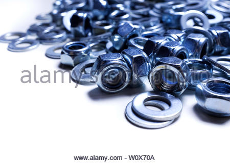 iron washers and nuts mixed up close-up, texture, background - Stock Photo