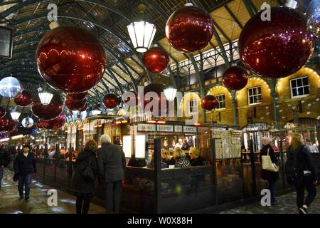 London/UK - November 27, 2013: People eating at the Covent Garden restaurant space during Christmas holidays. - Stock Photo