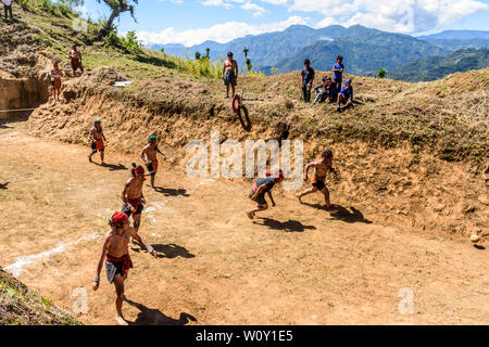 San Andres Semetabaj, Lake Atitlan, Guatemala - November 10, 2018:  Local indigenous Maya men play Maya ballgame in a newly dug ballgame court. - Stock Photo