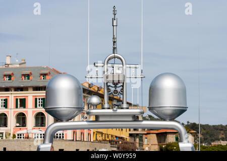 Detail of luxury grey yacht with navigation equipment, radar and antennas. Portovenere, Liguria, Italy - Stock Photo