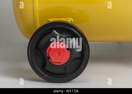 Yellow Piston Air Compressor. Compressing and Supplying Air Machine. Technical Equipment. - Stock Photo