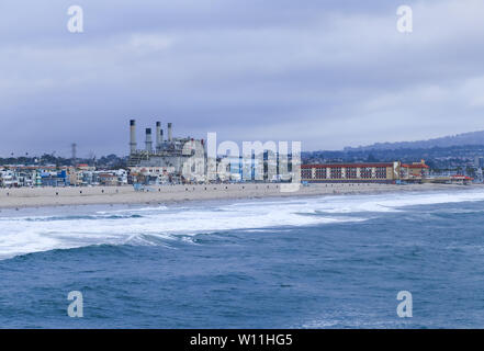 HERMOSA BEACH, USA - MAY 21, 2019: The Shoreline of Hermosa Beach (Los Angeles) with many houses and the power plant. - Stock Photo