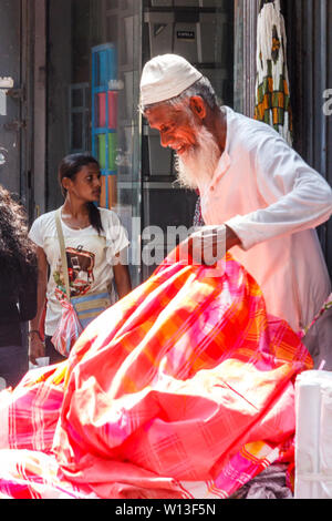 Colombo. Sri Lanka - December 21st 2016: Muslim man selling cloth in the Pettah District. This is the main commercial area. - Stock Photo