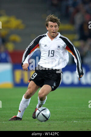 Rhein-Energie-Stadion Cologne Germany, 31.3.2004, Football: International friendly, Germany (white) vs. Belgium (red) 3:0 --- Bernd Schneider (GER) - Stock Photo