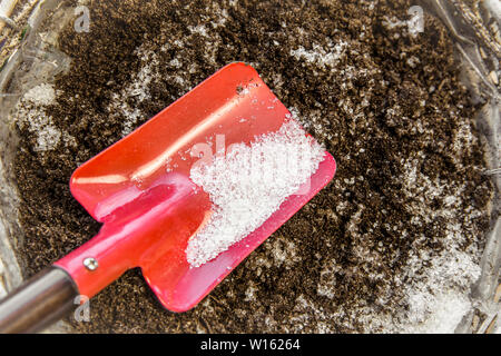 Water gel granules absorb water and stored water is available to release gradually to plant roots as needed gives healthier growing environment. Preve - Stock Photo