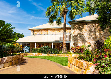 Cottage style building within tropical gardens. The Office of the Administrator in Darwin - Australia - Stock Photo