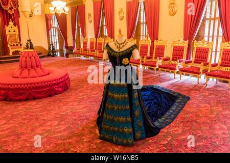 Interior of the Iolani Royal Palace in Honolulu, Oahu, Hawaii, Throne Room, Peacock dress - Stock Photo